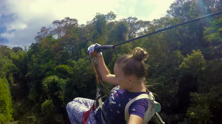 zipline : Female Tourist Riding Canopy in Laos