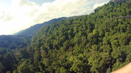 zip line : Riding Zip-Line in Lush Jungles of Laos Stock Footage