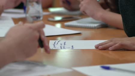 prospective : Business Planning. Discussion young people in the new company. You only see the hands. Stock Footage