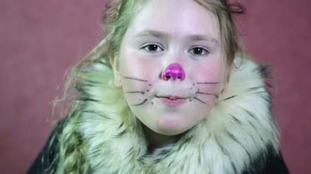 kostüm : Little girl dressed a cat costume Draw a mustache and nose. Close-up Stok Video