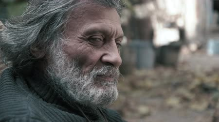 An elderly Afghan man looks at the camera (close-up)