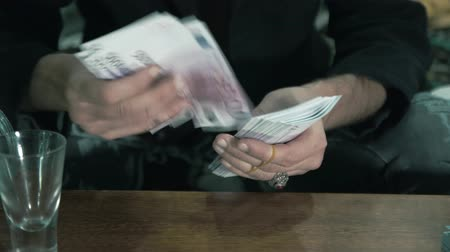 Male hands counting cash. Illegal trades 4K
