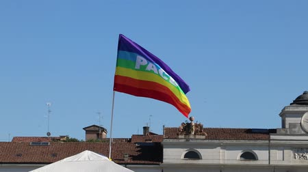 symbol of respect : Peace flag on the sky in an italian city