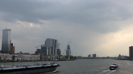 General view of Rotterdam city landscape with moving boat. 4K Footage.
