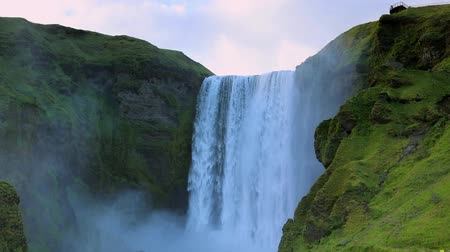 doğa : Picturesque landscape of a mountain waterfall and traditional nature of Iceland. HD Footage. Stok Video