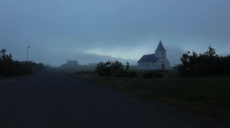 nordic countries : Traditional Icelandic village with church and beautiful morning landscape. Slow Motion Footage. Stock Footage