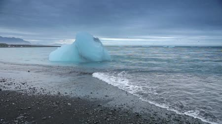 Glaciers on the beaches of Iceland. Slow Motion Footage.