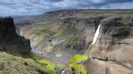 lélegzetelállító : Picturesque landscape of a mountain waterfall and traditional nature of Iceland. Slow Motion Footage.