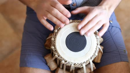 instrumento : Playing Bongo drum close up HD stock footage. Hand tapping a Bongo drum in close up.