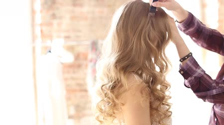 curling hair : Close-up of hairdresser doing beautiful wedding hairstyle.