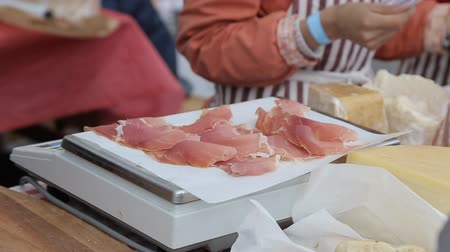 italian speciality : Thin slices of pork ham on the wood plate Stock Footage