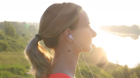 buty sportowe : Healthy Active Lifestyle. Young Attractive Jogger Woman Listening to Music. Wideo