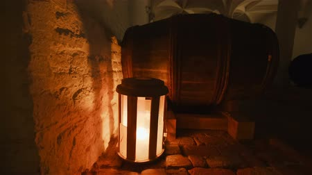 pince : Detail of a barrel in an old cellar with a flickering light in the background Stock mozgókép
