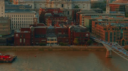 millennium : An aerial view featuring the St Pauls Cathedral, River Thames and Millennium Bridge in London, UK