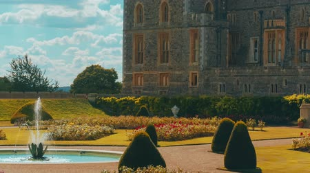 west wing : A close-up view of the west wing of Windsor Castle and gardens on a sunny day Stock Footage