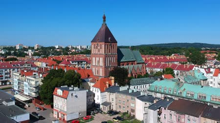 KOSZALIN, POLAND - AUGUST 3 2018 - Slow flying towards neo gothic cathedral from 14th century on August 03, 2018 in Koszalin city