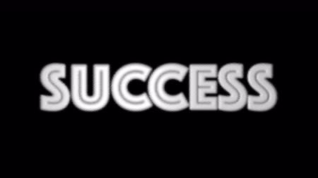 scatters : Animation of SUCCESS words text scatter on black background. business concept Stock Footage