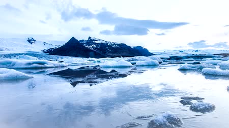 ice floes in timelapse Glacial lagoon at Breiamerkurjkull glacier in Iceland Stock Footage