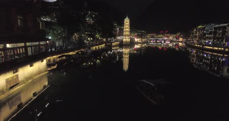 night scene : Fenghuang Ancient Town. Located in Fenghuang County. Southwest of HuNan Province, China. View of illuminated riverside houses. Stock Footage