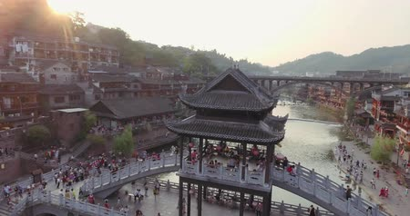 bird list : Fenghuang, China - September 16, 2015: Aerial Shot of Famous Stone Old Fashioned Chinese Bridge in Ancient Town in Fenghuang County, China on September 16,2016.