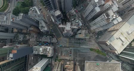 felhőkarcoló : Top view aerial footage from flying drone of metropolitan city HongKong with development buildings, transportation, energy power infrastructure. Financial and business centers in developed China town. Stock mozgókép