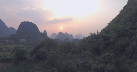 guangxi : Beautiful aerial landscape of Guilin,Li River, karst mountains in Cuiping Village at sunset. Top view of area located in Yangshuo County,Guangxi Province,China.Travelling to unique destination concept