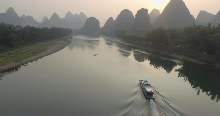 guangxi : Aerial view of sunrise over landscape of Yangshuo, Guanxi province, Guilin City, China. Li River and karst mountains top view. Travel, adventure and picturesque famous destination concept.