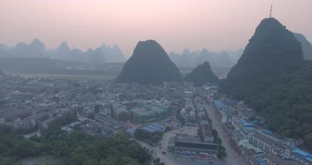 guangxi : Top view of amaizing famous Yangshuo valley in Guilin, Guangxi, China. Aerial View of beautiful sunrise over Yangshuo Town in Guilin, China. Overpopulation concept, beauty in nature