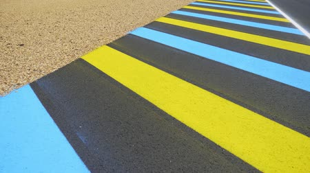 urban exploration : Closeup of asphalt highway with road markings, white and colorful solid lines. Transportation, speed and safety driving concept. Asphalt road with white stripes.