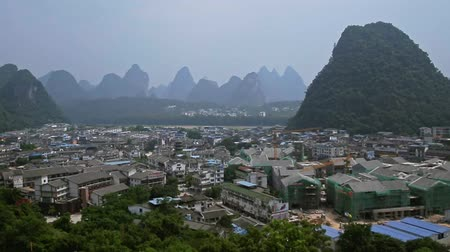 guangxi : Handheld shot of small famous town or village Yangshuo in Guilin, China. Destination, exploration and tourism concept. Stock Footage