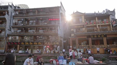 anka kuşu : FENGHUANG, HUNAN, CHINA - OCTOBER 05, 2017: The Old Town of Phoenix (Fenghuang Ancient Town) in the daytime. The popular tourist attraction which is located in Fenghuang County, Hunan, China. Stok Video