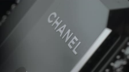 perfumy : Kuala Lumpur, Malasia - January 1, 2018: Chanel brand sign on luxury watch. It is a high fashion house that specializes in ready-to wear clothes, luxury goods and fashion accessories.