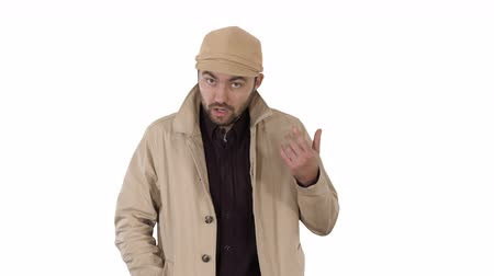 költő : A positive bearded male dressed in a trench coat walking and talking on white background.
