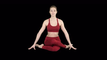 pilates : Yoga girl practicing nadi shodhana pranayama or Breathingin in gomukhasana asana or cow head pose, Alpha Channel