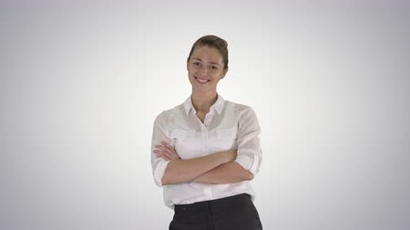 charisma : Looking great Marvelous optimistic business woman smiling on gradient background. Stock Footage