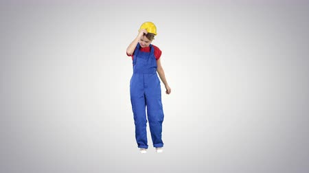 invisible : Tradeswoman dancing Construction uniform dressed woman on gradient background.
