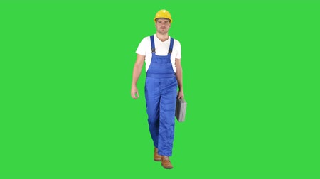 toolbox : Carpenter walking on a Green Screen, Chroma Key.