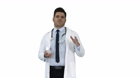 rekomendacja : Clinician Doctor Man Showing Drugs Medication and Talking to Camera on white background. Wideo