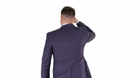 looking far away : Businessman walking and looking far away on white background. Stock Footage