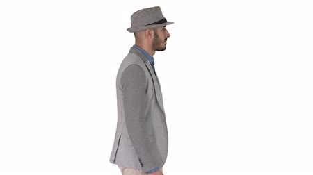 haver : Casual arabic man in hat walking on white background.