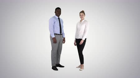 african decent : International happy smiling man and woman showing thumbs up on gradient background. Stock Footage