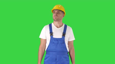 védősisak : Architect or engineerpresenting new house or building on a Green Screen, Chroma Key. Stock mozgókép