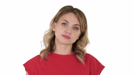 teljes hosszúságú : Young woman red t-shirt is walking, looking at camera on white background.