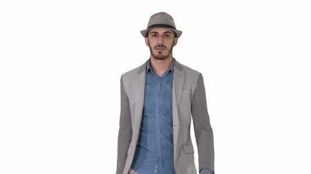 relance : Casual arabian man walking in a hat and with a briefcase on white background. Vídeos
