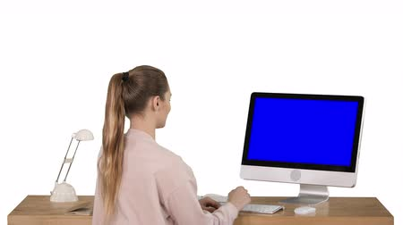 netbook : Attractive casual businesswoman working at office using pc Blue Screen Mock-up Display on white background. Stock Footage