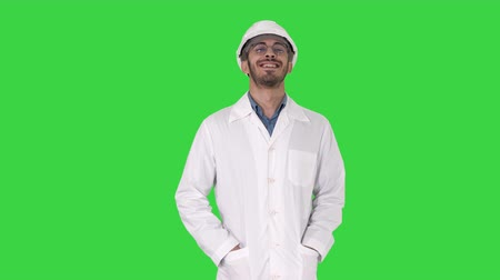 atitude : Happy engineer walking Great result on a Green Screen, Chroma Key.
