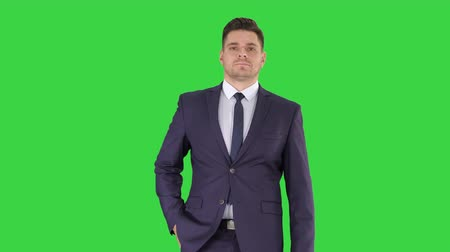 fulllength : Thoughtful businessman walking on a Green Screen, Chroma Key. Stock Footage