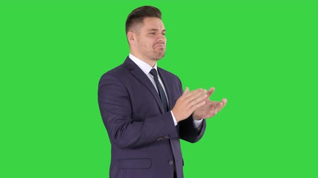 ovation : Businesses man applauding on a Green Screen, Chroma Key. Stock Footage