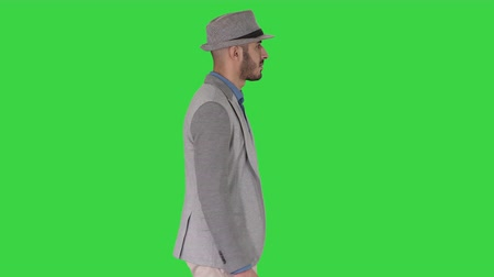 haver : Casual arabic man in hat walking on a Green Screen, Chroma Key.