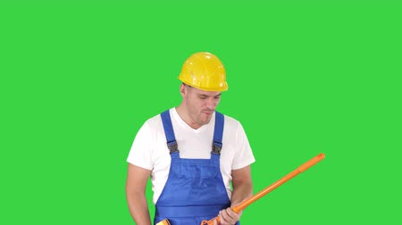 паркет : Cheerful man playing on the swob like it is a guitar on a Green Screen, Chroma Key.